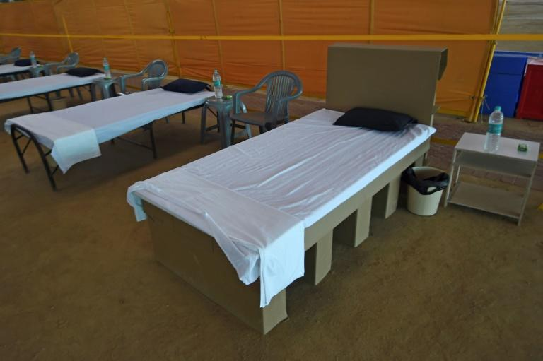 The New Delhi government is installing thousands of cardboard beds in a spiritual centre on the outskirts of the city that is being converted into a makeshift medical facility for COVID-19 patients (AFP Photo/Money SHARMA)