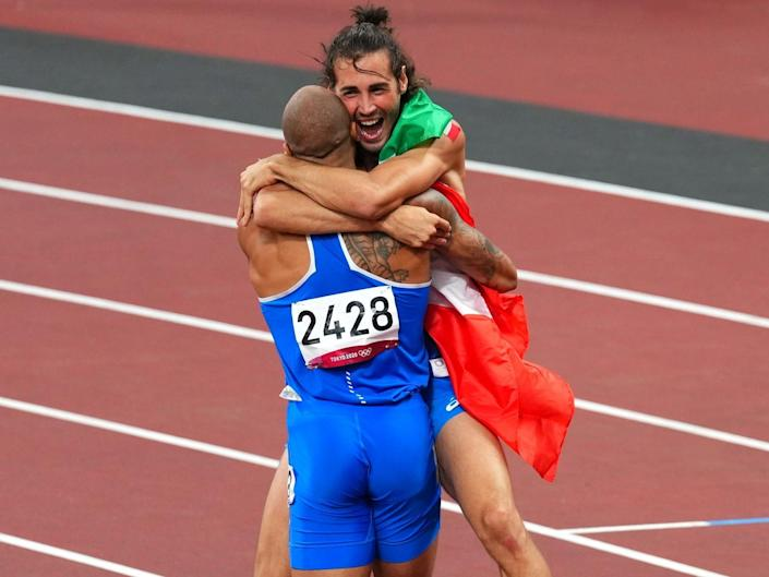Lamont Marcell Jacobs celebrates with Gianmarco Tamberi after both won gold for Italy.