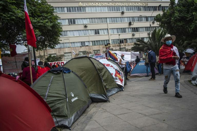 Supporters of Peru's left-wing presidential candidate Pedro Castillo camp outside the building of the National Jury of Elections in Lima on July 06, 2021