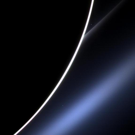 Venus gleams as a bright dot between Saturn's limb and its G ring near the top of this photo, which NASA's Cassini spacecraft took on Jan. 4, 2013.