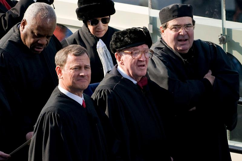 Stevens (center) attends the inauguration of President Barack Obama in 2009. Standing around him (clockwise from his immediate left) are Chief Justice John Roberts and Justices Clarence Thomas, Ruth Bader Ginsburg and Antonin Scalia. (Photo: Bloomberg via Getty Images)
