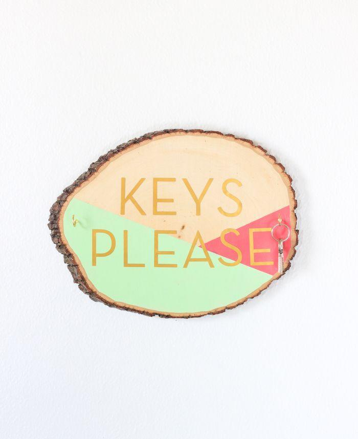 "<p>Never forget your keys again thanks to this colorful wood slice key holder. Paint the front in bold, vivid colors, so you can't miss it on the way out the door.</p><p>Get the tutorial at <a href=""http://thecraftedlife.com/diy-wooden-slab-key-holder/"" rel=""nofollow noopener"" target=""_blank"" data-ylk=""slk:The Crafted Life"" class=""link rapid-noclick-resp"">The Crafted Life</a>.</p>"