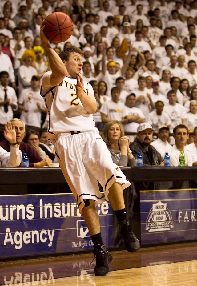Cowboys junior guard Riley Grabau (2) saves the ball from going out of bounds Tuesday, Feb. 11, 2014 against Sand Diego State at the Arena-Auditorium in Laramie, Wyo. (AP Photo/Jeremy Martin)