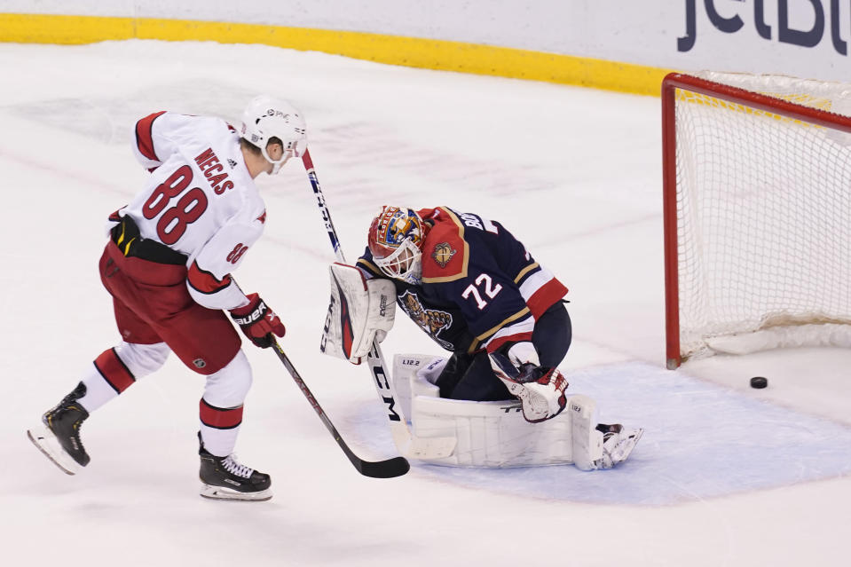 Carolina Hurricanes center Martin Necas (88) scores the winning goal on Florida Panthers goaltender Sergei Bobrovsky (72) in a shootout at an NHL hockey game, Saturday, Feb. 27, 2021, in Sunrise, Fla. The Hurricanes defeated the Panthers 4-3. (AP Photo/Marta Lavandier)