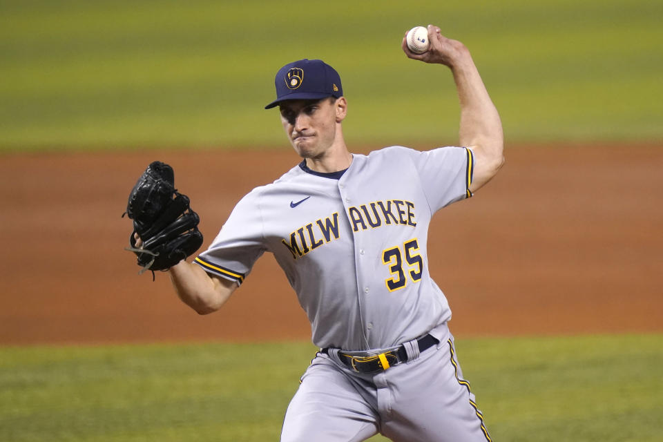 Milwaukee Brewers starting pitcher Brent Suter throws during the first inning of the team's baseball game against the Miami Marlins, Friday, May 7, 2021, in Miami. (AP Photo/Lynne Sladky)