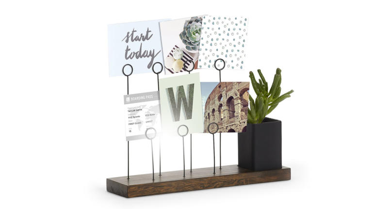 A dynamic photo holder display in aged walnut. Room for 7 photos plus planter and pen holder (Photo: Umbra)