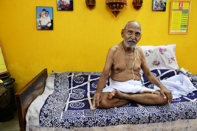 Swami performs routinized yoga every day