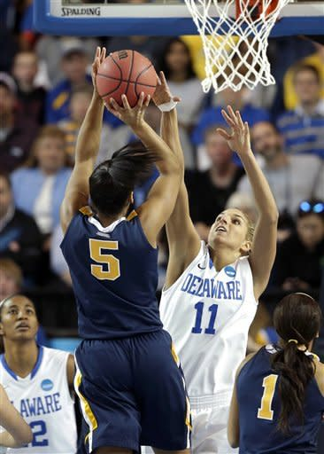 Delaware guard/forward Elena Delle Donne (11) attempts to block a shot by West Virginia forward Averee Fields during the first half of a first-round game in the women's NCAA college basketball tournament in Newark, Del., Sunday, March 24, 2013. (AP Photo/Patrick Semansky)