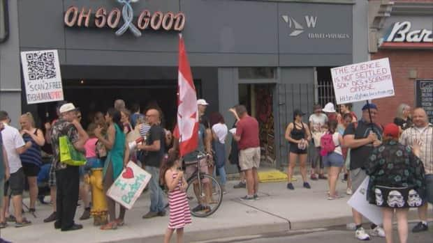 Some of the roughly 150 anti-lockdown and anti-mask protesters who gathered on York Street Saturday.