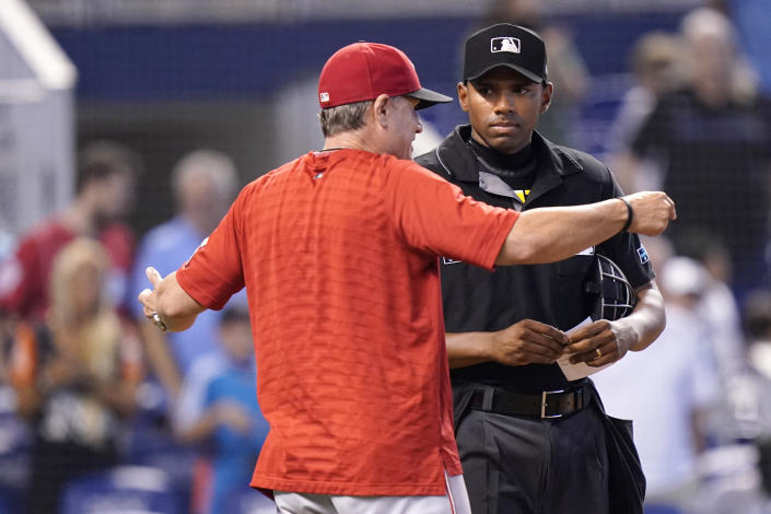 Cincinnati Reds manager David Bell, left, argues a call with home plate umpire Edwin Moscoso, right, during the ninth inning of a baseball game against the Miami Marlins, Sunday, Aug. 29, 2021, in Miami. (AP Photo/Lynne Sladky)