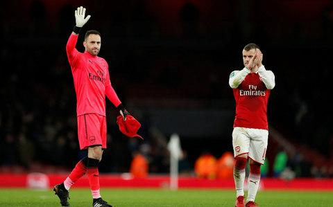 David Ospina and Jack Wilshere salute the crowd - Credit: Reuters