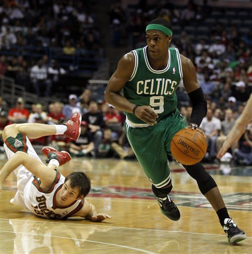 Boston Celtics' Rajon Rondo (9) drives past Milwaukee Bucks' Beno Udrih, left, during the first half of an NBA basketball game on Thursday, March 22, 2012, in Milwaukee. (AP Photo/Jeffrey Phelps)