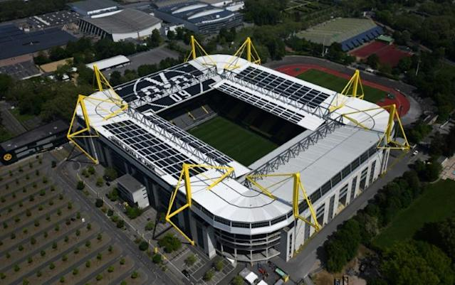 Borussia Dortmund's Signal Iduna Park would normally be packed with 81,000 people for the visit of Schalke 04 on Saturday. This time it will be empty. (AFP Photo/Ina FASSBENDER)