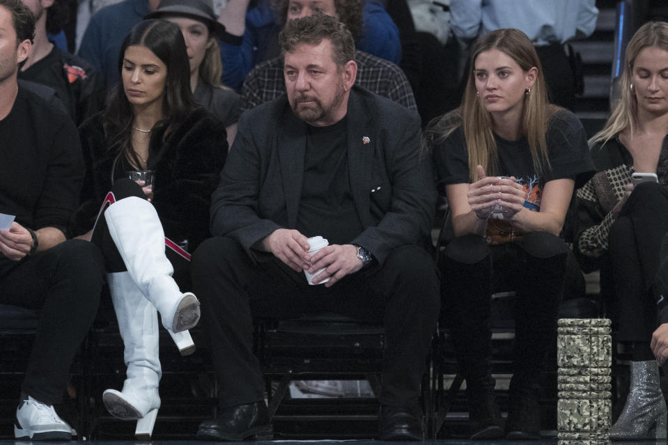 Madison Square Garden chairman James Dolan, center, watches the game action during the first half of an NBA basketball game between the New York Knicks and the Boston Celtics, Saturday, Oct. 20, 2018, at Madison Square Garden in New York. (AP Photo/Mary Altaffer)