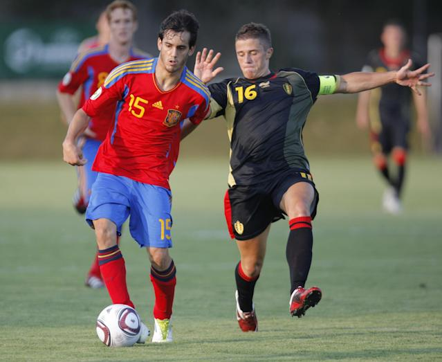 Juanmi (L) of Spain vies for the ball with Florent Cuvelier (R) of Belgium during their UEFA European Under-19 Championship 2010/2011 football final tournament in Mogosoaia village, next to Bucharest on July 21, 2011. Spain won 4-1. AFP PHOTO/ STRINGER (Photo credit should read -/AFP/Getty Images)