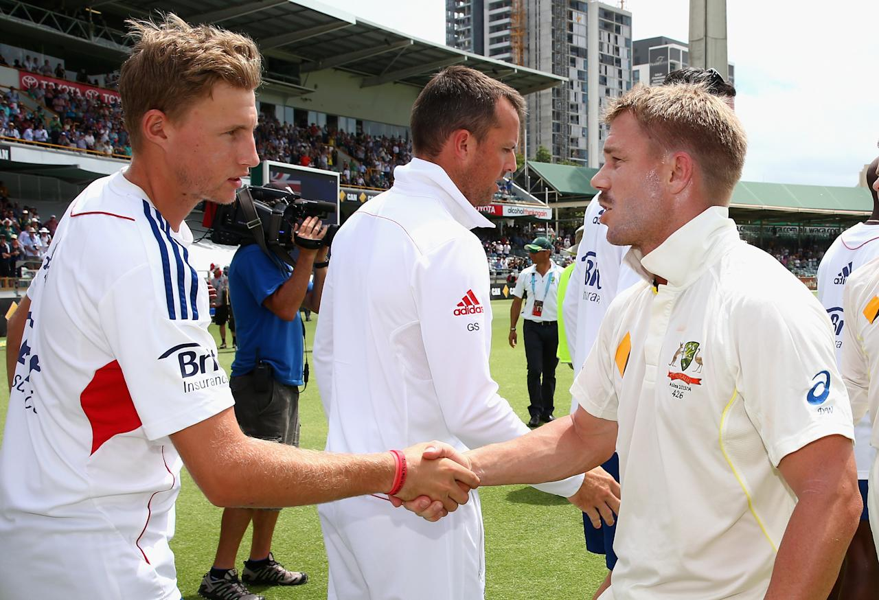 PERTH, AUSTRALIA - DECEMBER 17:  David Warner of Australia shakes hands with Joe Root of England during day five of the Third Ashes Test Match between Australia and England at WACA on December 17, 2013 in Perth, Australia.  (Photo by Ryan Pierse/Getty Images)