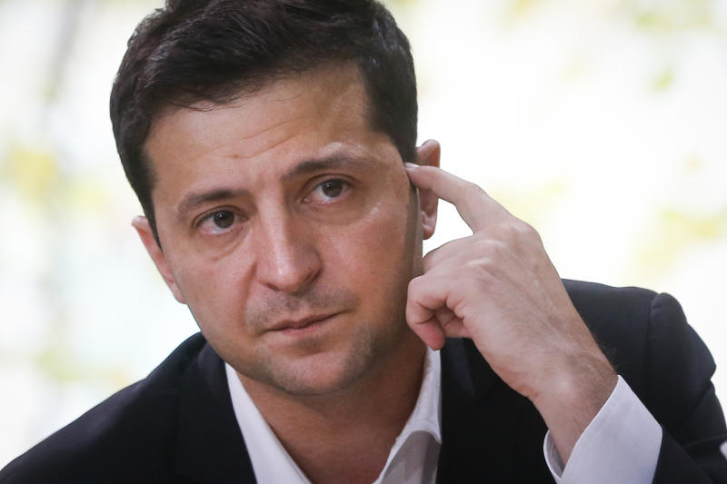 FILE In this file photo taken on Thursday, Oct. 10, 2019, Ukrainian President Volodymyr Zelenskiy attends his long time talks with journalists in Kyiv, Ukraine. Ukraine may be at the center of a major geopolitical battle, but it's feeling increasingly alone and abandoned by its U.S. backers amid the impeachment drama unfolding in Washington. Facing that reality, Zelenskiy is reaching out to Russia directly in a bid to end the conflict before things get worse. (AP Photo/Efrem Lukatsky, File)
