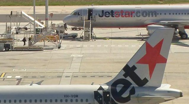Police have been forced to taser a man trying to sneak on to a Jetstar flight. Photo: 7 News