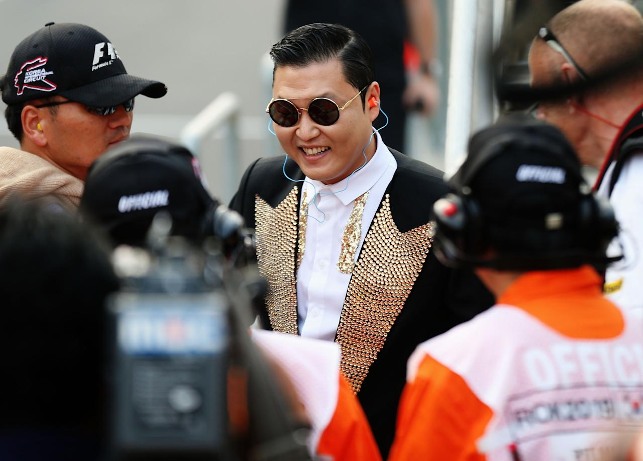 YEONGAM-GUN, SOUTH KOREA - OCTOBER 14:  Korean rapper Psy is seen in the pitlane following the Korean Formula One Grand Prix at the Korea International Circuit on October 14, 2012 in Yeongam-gun, South Korea.  (Photo by Mark Thompson/Getty Images)