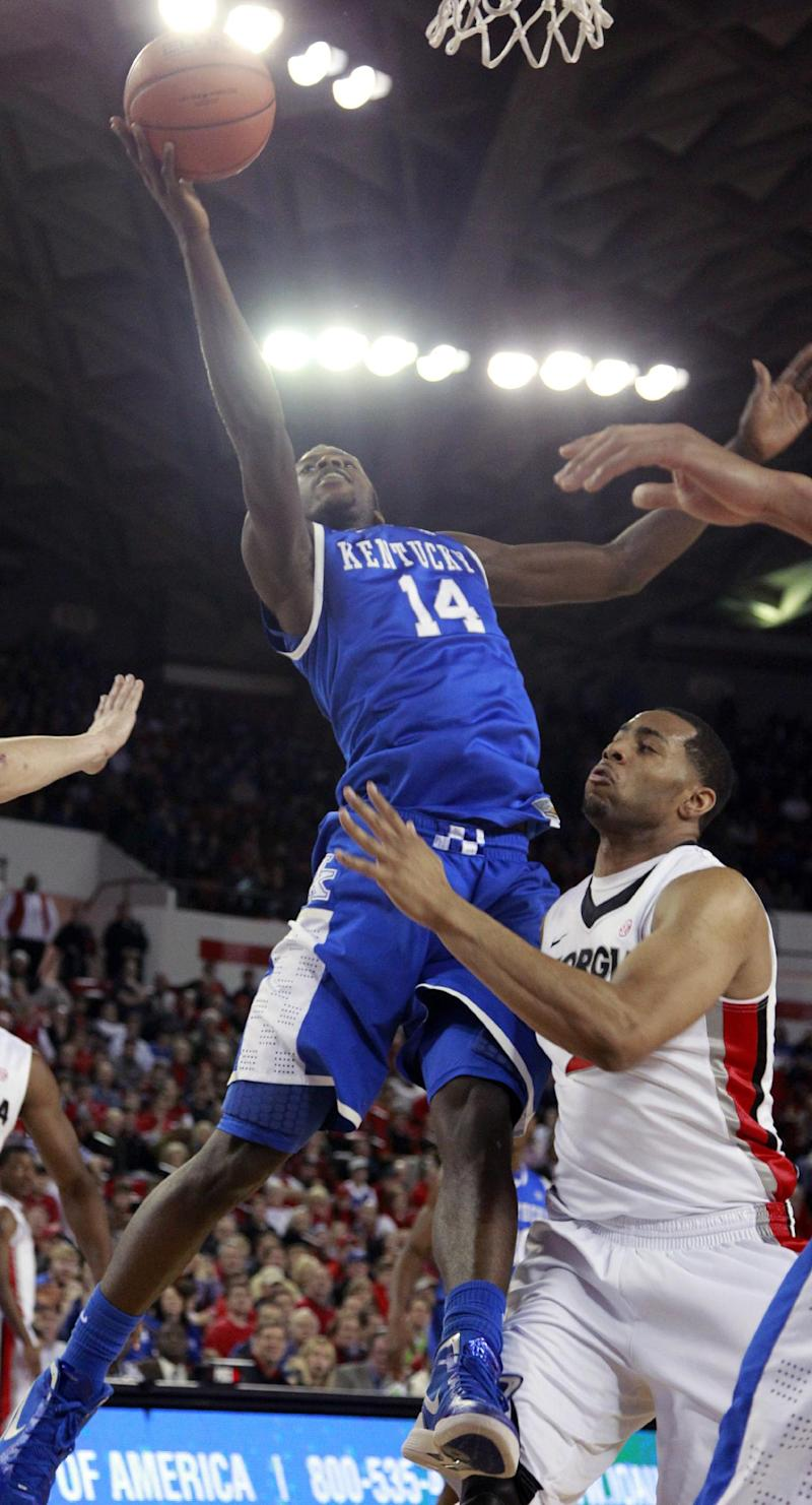 Kentucky forward Michael Kidd-Gilchrist (14) reaches  for a rebound as Georgia forward Marcus Thornton (2) defends in the first half of an NCAA college basketball game Tuesday, Jan. 24, 2012, in Athens, Ga. (AP Photo/John Bazemore)