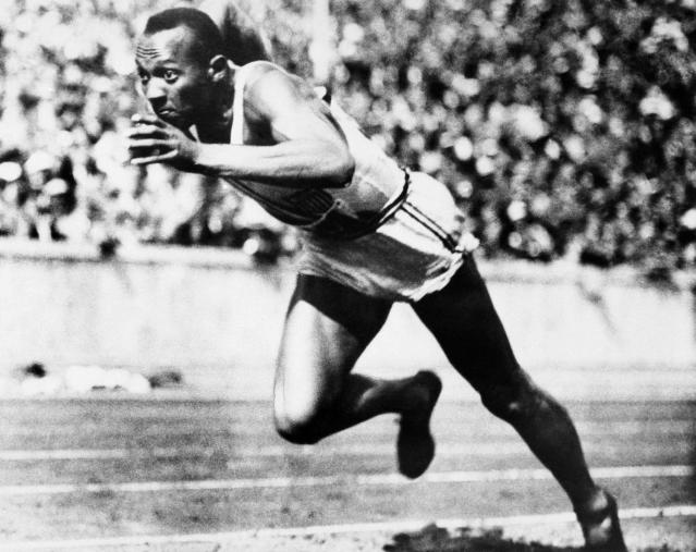 American sprint star Jesse Owens is shown in action during one of the heats of the 200-meter run August 14, 1936 in Berlin. He won the final with a new Olympic record of 20.7 seconds. (AP Photo)