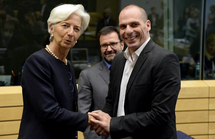 Greece's Finance Minister Yanis Varoufakis (R) shakes hands with IMF Managing Director Christine Lagarde, in Brussels on June 25, 2015 (AFP Photo/Thierry Charlier)