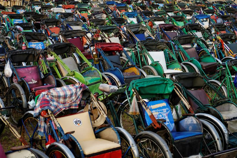 Tricycles lined up to provide seating for an outdoor movie screening held by a held by a NGO in Phnom Penh