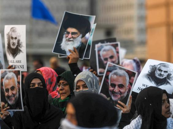Shia Muslims march to protest against the US strike that killed Soleimani (AFP)