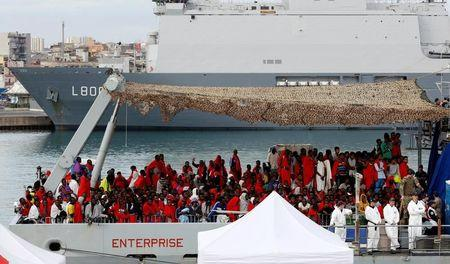 Migrants wait for disembark from Royal Navy Ship HMS Enterprise in the Sicilian harbour of Catania, Italy, October 23, 2016. REUTERS/Antonio Parrinello