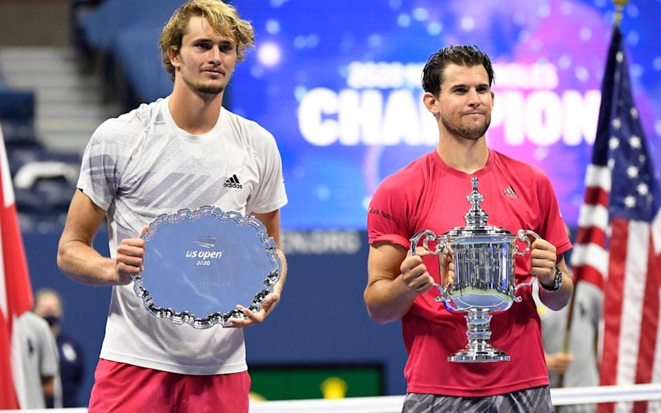 Alexander Zverev of Germany and Dominic Thiem of Austria pose with the finalist and championship trophies - USA TODAY Sports