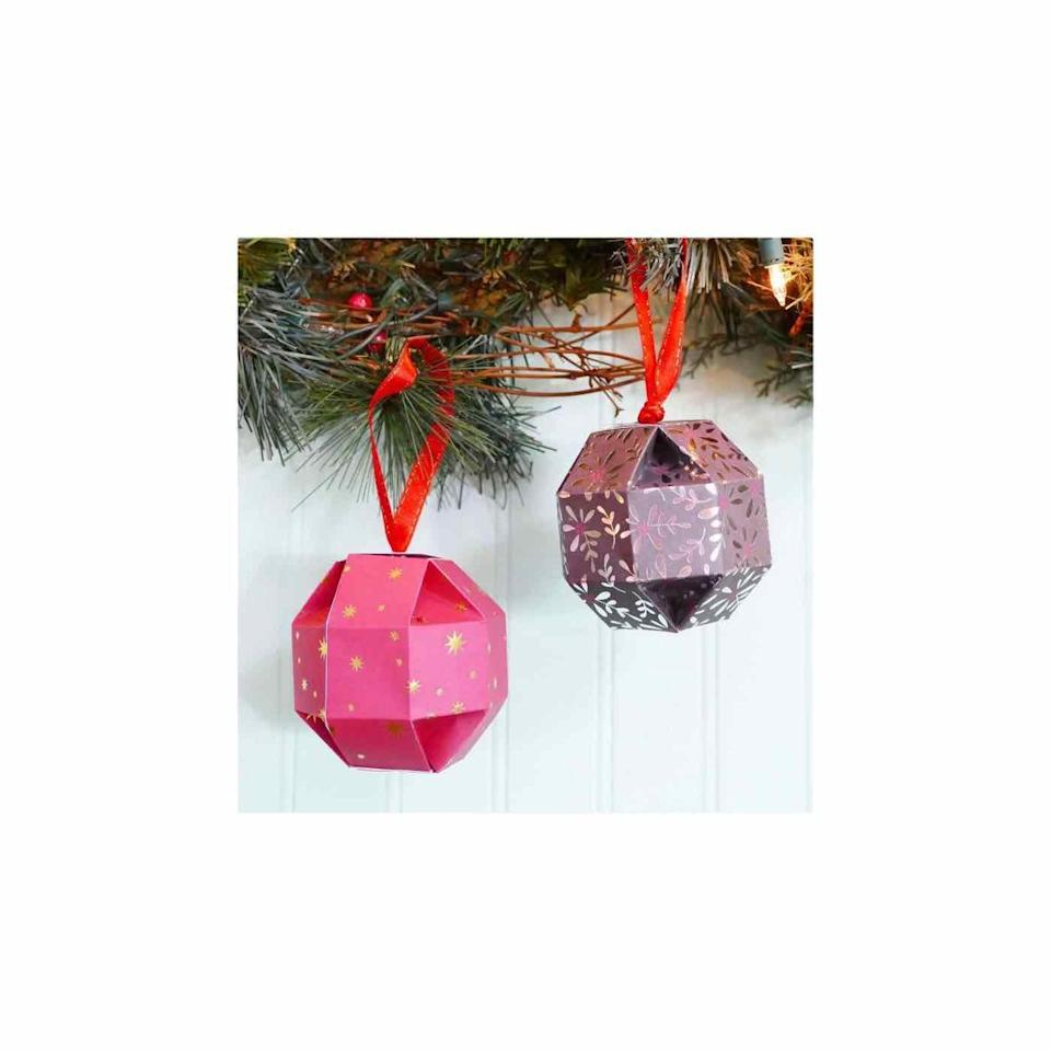 """<p>These paper orbs not only serve as ornaments, but also a clever way to wrap small gifts, like jewelry or stocking stuffers. </p><p><em>Get the tutorial at <a href=""""https://jennifermaker.com/paper-orb-gift-box-ornament/"""" rel=""""nofollow noopener"""" target=""""_blank"""" data-ylk=""""slk:Jennifer Maker"""" class=""""link rapid-noclick-resp"""">Jennifer Maker</a>.</em></p><p><a class=""""link rapid-noclick-resp"""" href=""""https://www.amazon.com/Besecraft-Cardstock-Scrapbooking-Multi-Colored-Decorative/dp/B0828WXFG9?tag=syn-yahoo-20&ascsubtag=%5Bartid%7C10072.g.34443405%5Bsrc%7Cyahoo-us"""" rel=""""nofollow noopener"""" target=""""_blank"""" data-ylk=""""slk:SHOP PATTERNED CARDSTOCK"""">SHOP PATTERNED CARDSTOCK</a></p>"""