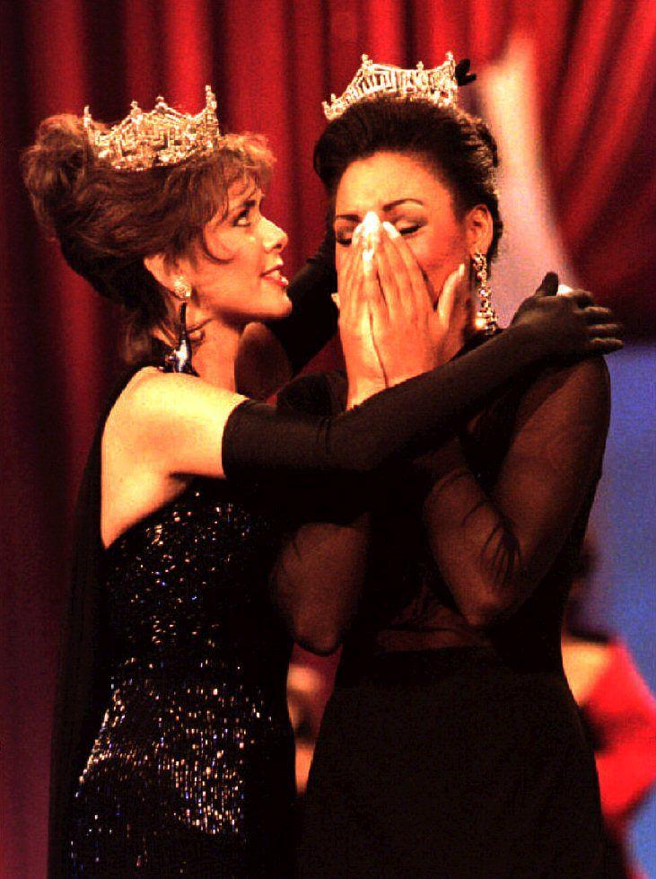 Miss South Carolina Kimberly Clarice Aiken (R) reacts after receiving the crown from last year's Miss America Leanza Cornett after Aiken won the Miss America Pageant 18 September 1993 in New Jersey. Aiken, 18, plans to help homeless people during her year-long reign.