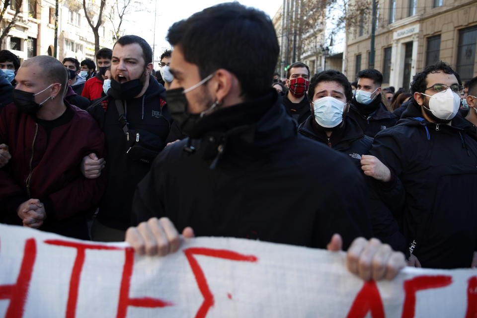 University students shout slogans during a rally against educational reforms in Athens, Thursday, Jan. 21, 2021. About 1,500 students took part in two separate protests against government's plans to set up a state security division at university campuses and time limits set for the completion of degree courses. (AP Photo/Thanassis Stavrakis)