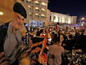 Supporters of Iraqi Shiite cleric Moqtada Sadr celebrate in Najaf after the closure of polls on October 10, 2021 (AFP/Ali NAJAFI)