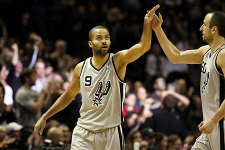 Dec 29, 2013; San Antonio, TX, USA; San Antonio Spurs guard Tony Parker (9) celebrates a score with Manu Ginobili (right) during the second half against the Sacramento Kings at the AT&T Center. Soobum Im-USA TODAY Sports