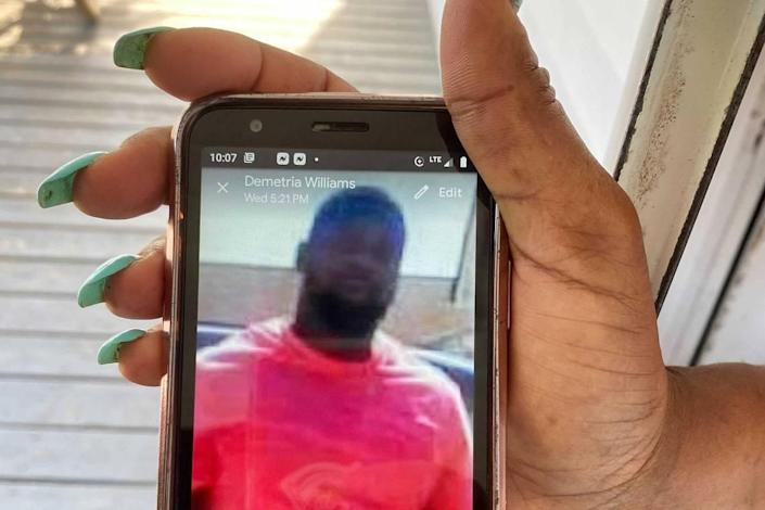Demetria Williams showing a photo of her neighbor and longtime friend, Andrew Brown, who was shot and killed Wednesday, April 21, 2021 by Pasquotank County Sheriff's deputies