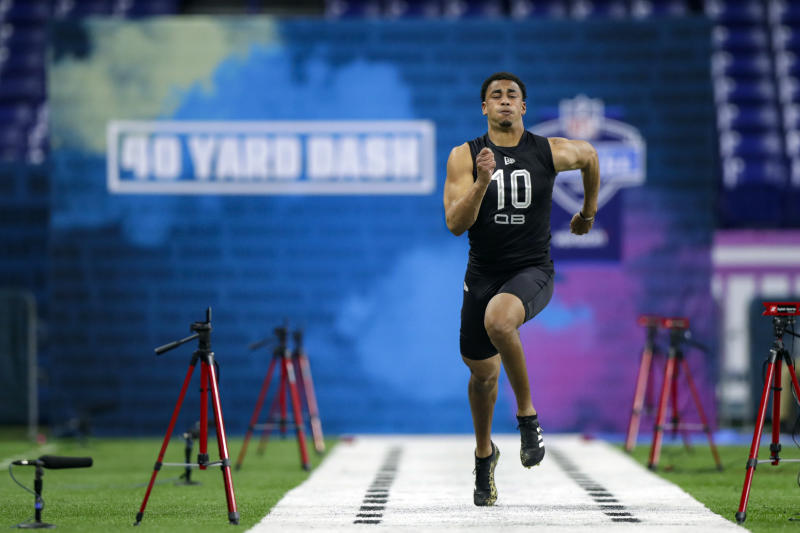 FILE - In this Thursday, Feb. 27, 2020, file photo, Utah State quarterback Jordan Love runs the 40-yard dash at the NFL football scouting combine in Indianapolis. After turning heads last month at the Senior Bowl, Love delivered with another impressive workout Thursday. (AP Photo/Michael Conroy, File)
