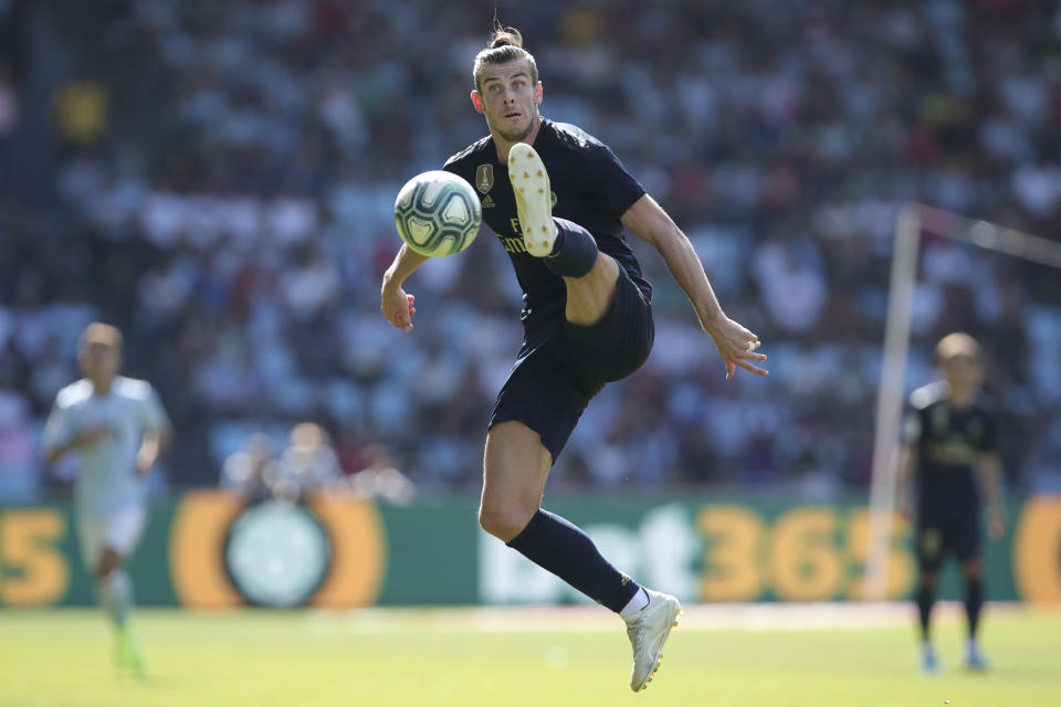 Real Madrid's Gareth Bale jumps to control the ball during La Liga soccer match between Celta and Real Madrid at the Balados Stadium in Vigo, Spain, Saturday, Aug. 17, 2019. (AP Photo/Luis Vieira)