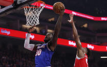 New York Knicks forward Julius Randle, left, goes to the basket past Sacramento Kings guard Buddy Hield during the first quarter of an NBA basketball game in Sacramento, Calif., Friday, Dec. 13, 2019. (AP Photo/Rich Pedroncelli)
