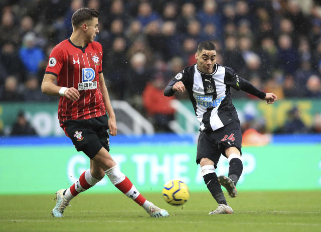 Newcastle United's Miguel Almiron, right, shoots towards goal, during the English Premier League soccer match between Newcastle United and Southampton, at St James' Park, in Newcastle, England, Sunday, Dec. 8, 2019. (Owen Humphreys/PA via AP)
