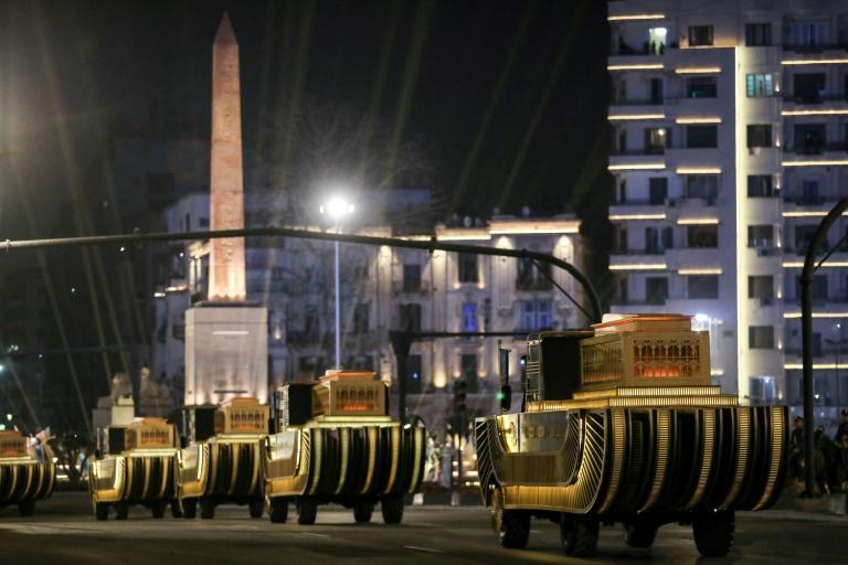 The carriages carrying 22 ancient Egyptian royal mummies advance past the Obelisk of Ramses II along Tahrir Square as they depart from the Egyptian Museum to their new home