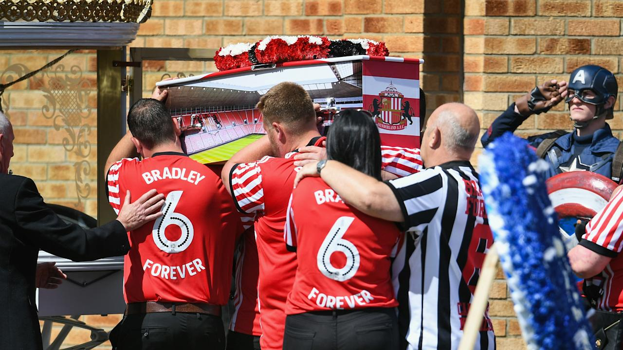 Relatives, friends and mourners dressed as superheroes all attended the Sunderland fan's funeral, along with the Bournemouth striker