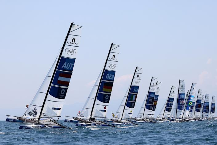 <p>FUJISAWA, JAPAN - AUGUST 01: The Nacra 17 Foiling class head out to compete on day nine of the Tokyo 2020 Olympic Games at Enoshima Yacht Harbour on August 01, 2021 in Fujisawa, Kanagawa, Japan. (Photo by Phil Walter/Getty Images)</p>