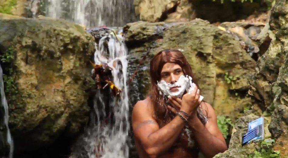 The clip shows the medication coach getting in touch with his wild side as he adopts the character of a caveman. Photo: Youtube/Dino Hira