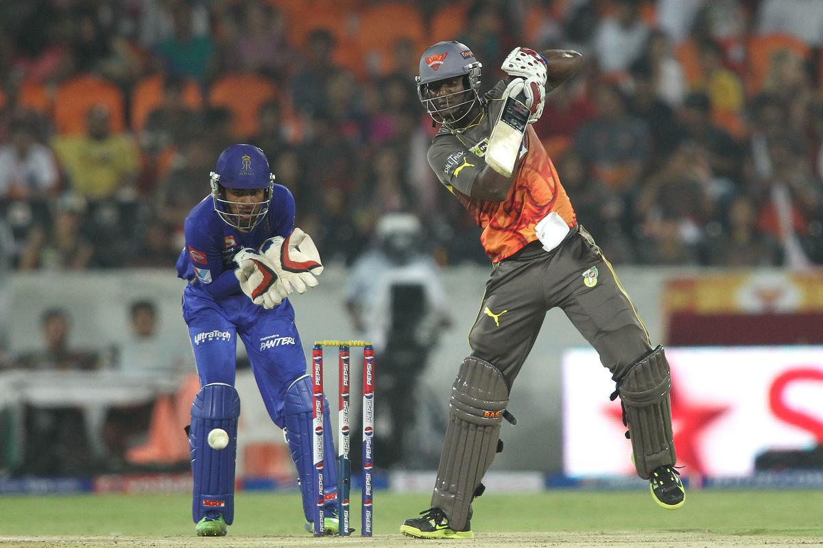 Darren Sammy of Sunrisers Hyderabad drives a delivery off the back foot during match 68 of the Pepsi Indian Premier League between The Sunrisers Hyderabad and The Rajasthan Royals held at the Rajiv Gandhi International Stadium, Hyderabad  on the 17th May 2013..Photo by Shaun Roy-IPL-SPORTZPICS ..Use of this image is subject to the terms and conditions as outlined by the BCCI. These terms can be found by following this link:..https://ec.yimg.com/ec?url=http%3a%2f%2fwww.sportzpics.co.za%2fimage%2fI0000SoRagM2cIEc&t=1506047847&sig=SYLW7hgXDvXZYVjUaoIGVQ--~D