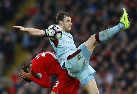 Britain Football Soccer - Liverpool v Burnley - Premier League - Anfield - 12/3/17 Burnley's Ashley Barnes in action with Liverpool's Emre Can  Action Images via Reuters / Jason Cairnduff Livepic