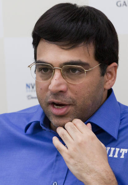 World Chess champion Viswanathan Anand from India, speaks during a press conference after tie break match against Boris Gelfand of Israel, at the FIDE World Chess Championship at Moscow's Tretyakovsky State Gallery, Russia, Wednesday, May 30, 2012. Anand has retained his FIDE world champion's title. (AP Photo/Misha Japaridze)