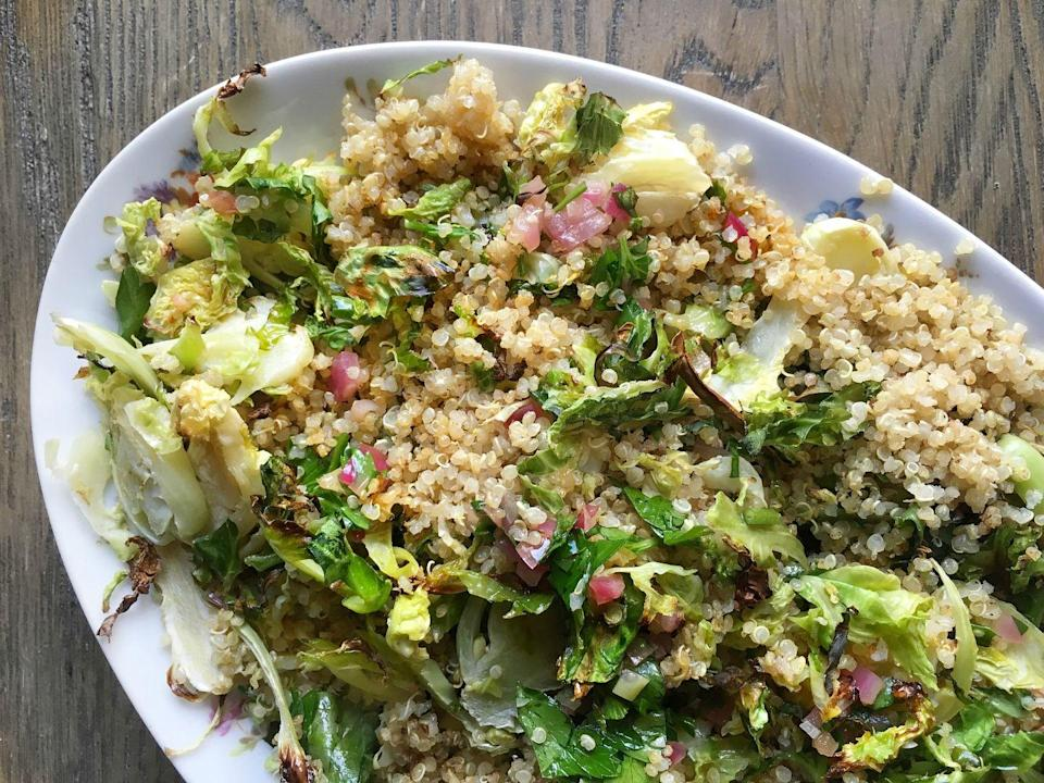 """<p>These Brussels coated in warm red onion vinaigrettes will blow any salad out of the water.</p><p>Get the recipe from <a href=""""https://www.delish.com/cooking/recipe-ideas/recipes/a46415/roasted-brussels-sprouts-and-quinoa-with-warm-red-onion-vinaigrette-recipe/"""" rel=""""nofollow noopener"""" target=""""_blank"""" data-ylk=""""slk:Delish"""" class=""""link rapid-noclick-resp"""">Delish</a>.</p>"""
