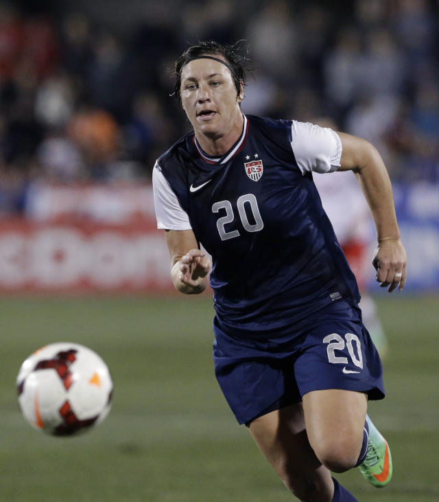 USA forward Abby Wambach (20) chases the ball during the first half of a soccer game Friday, Jan. 31, 2014, in Frisco, Texas. (AP Photo/LM Otero)