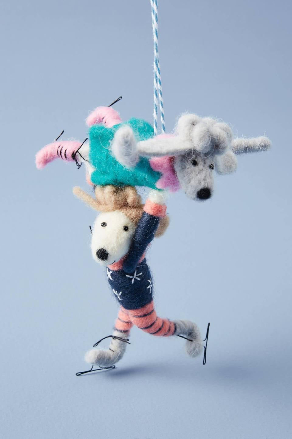 """<p>Give your tree whimsical flair with this <a href=""""https://www.popsugar.com/buy/Ice-Skating-Poodles-Ornament-490547?p_name=Ice%20Skating%20Poodles%20Ornament&retailer=anthropologie.com&pid=490547&price=24&evar1=casa%3Aus&evar9=46615300&evar98=https%3A%2F%2Fwww.popsugar.com%2Fhome%2Fphoto-gallery%2F46615300%2Fimage%2F46615418%2FIce-Skating-Poodles-Ornament&list1=shopping%2Canthropologie%2Choliday%2Cchristmas%2Cchristmas%20decorations%2Choliday%20decor%2Chome%20shopping&prop13=mobile&pdata=1"""" rel=""""nofollow noopener"""" class=""""link rapid-noclick-resp"""" target=""""_blank"""" data-ylk=""""slk:Ice Skating Poodles Ornament"""">Ice Skating Poodles Ornament</a> ($24).</p>"""